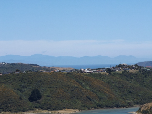 The view across Onepoto to the hills of the South Island looking blue in the heat haze.